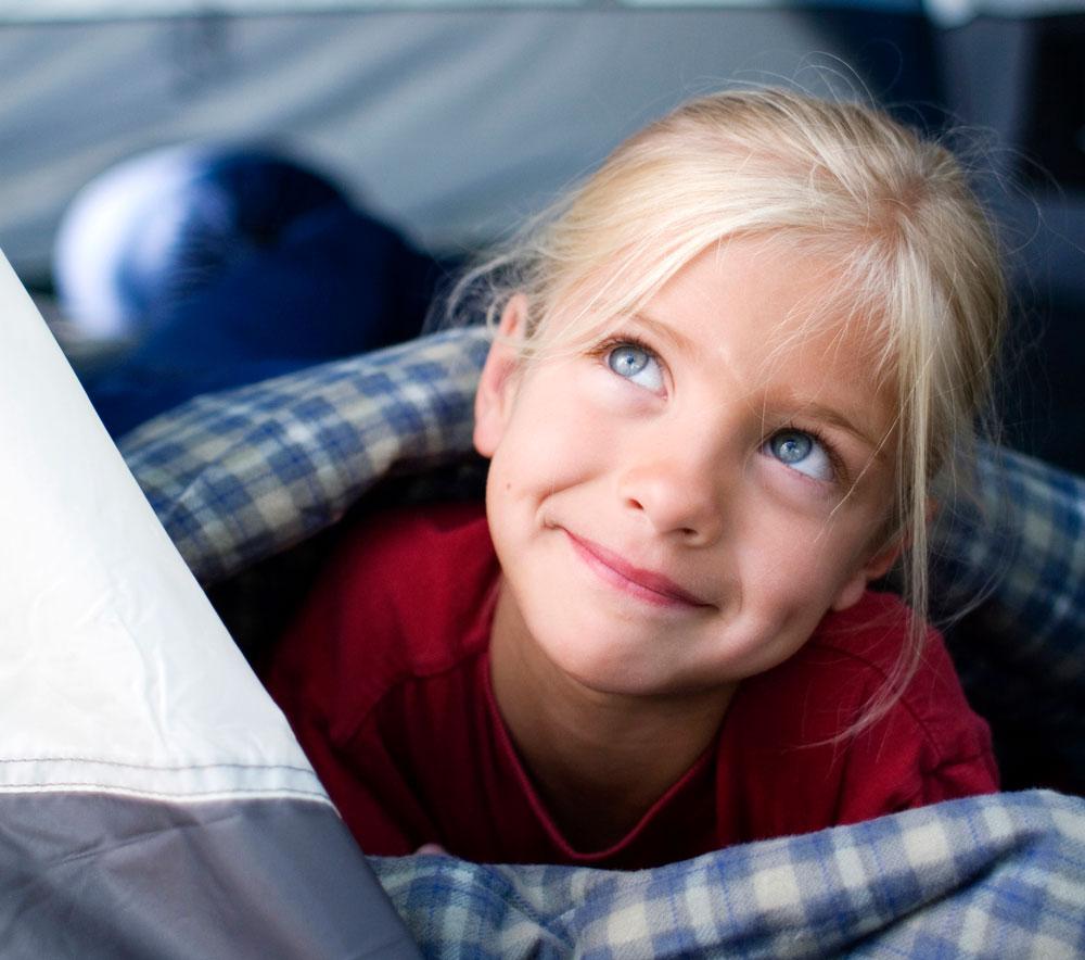 Girl enjoying camping in a tent